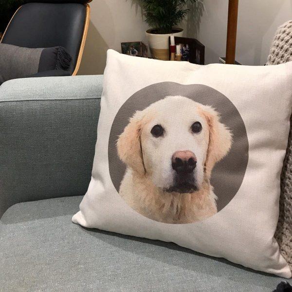 golden retriever canvas cushion on a sofa